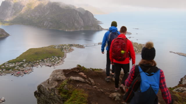 friends doing hiking in the lofoten islands. - travel destinations stock videos & royalty-free footage