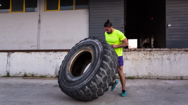 WS friends doing workout flipping tractor tires