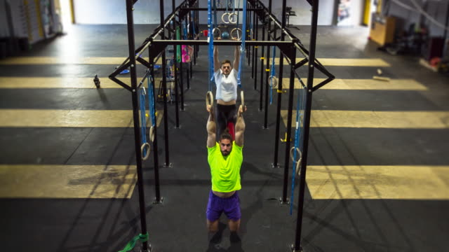 ws friends doing workout in gym - gymnastic rings stock videos & royalty-free footage