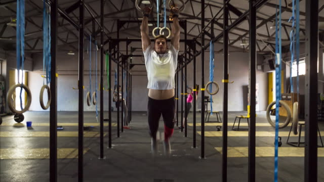 ms friends doing workout in gym - gymnastic rings stock videos & royalty-free footage