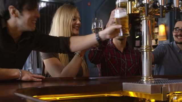 friends drinking at the bar counter - pub stock videos & royalty-free footage