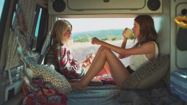 friends drinking coffee while relaxing in van - van vehicle stock videos and b-roll footage