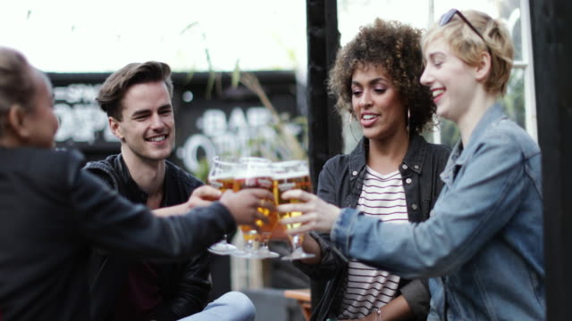 friends drinking in an outdoor bar in summer - happy hour video stock e b–roll