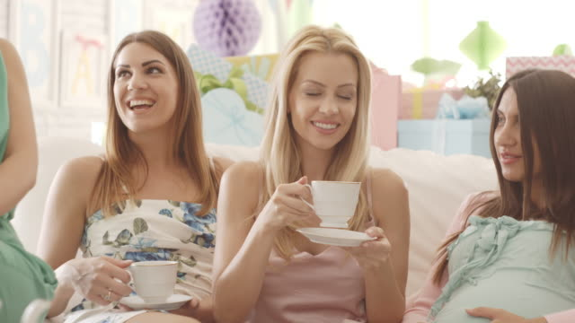 friends drinking tea on baby shower party - tea party stock videos and b-roll footage