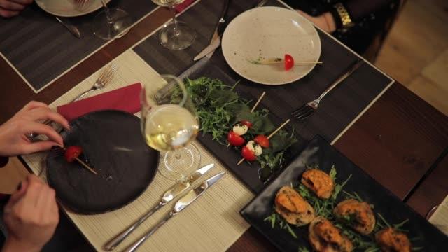 Friends eating dinner in restaurant