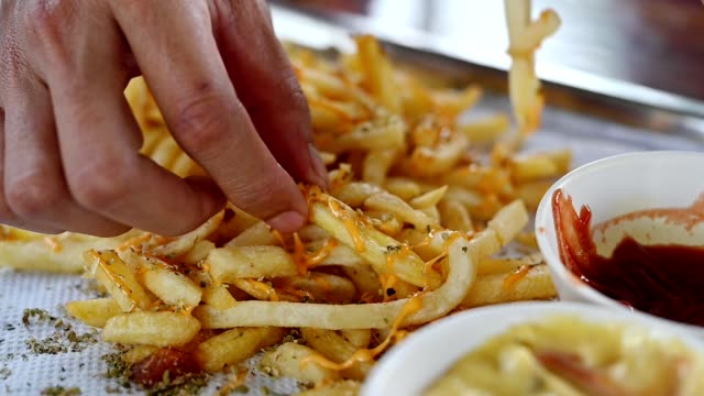 friends eating french fries with cheese and tomato sauce - slice stock videos & royalty-free footage