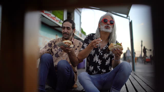 friends eating street food together - puerto madero stock videos & royalty-free footage