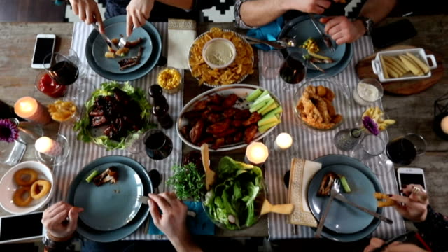 friends eating thanksgiving dinner - lunch stock videos & royalty-free footage