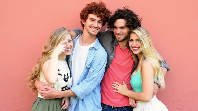 friends embracing and laughing - halbnahe einstellung stock-videos und b-roll-filmmaterial