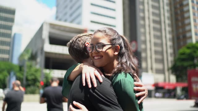 friends embracing at city - reconciliation stock videos & royalty-free footage
