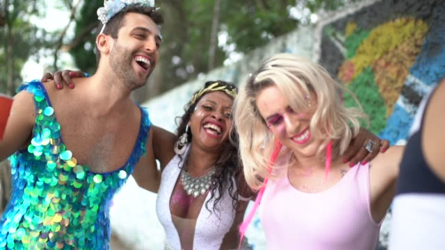 friends embracing each other and dancing at carnival party in brazil - pride stock videos & royalty-free footage