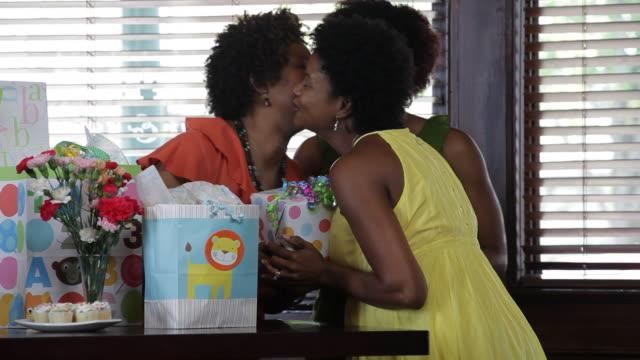 friends enjoy a baby shower. - baby shower video stock e b–roll