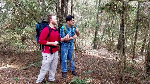 Friends enjoy nature on hiking trip.