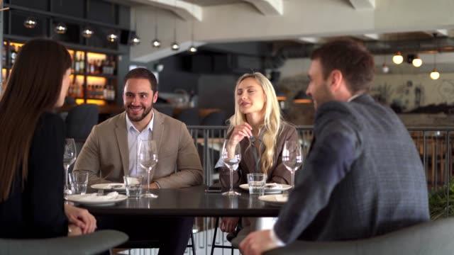 friends enjoying a lunch break - business lunch stock videos & royalty-free footage