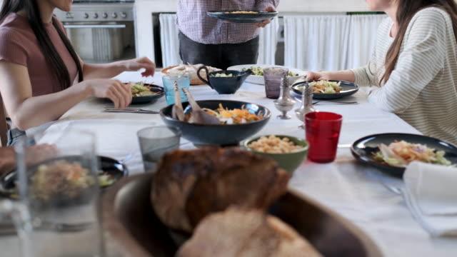 friends enjoying a vegan meal - service stock videos & royalty-free footage