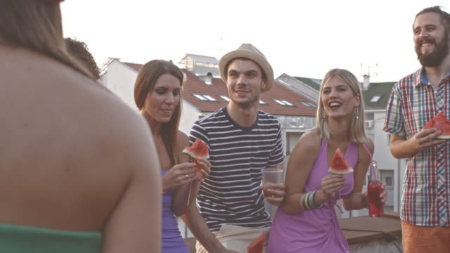 friends enjoying at rooftop party - patio stock videos & royalty-free footage
