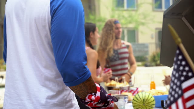 friends enjoying barbecue 4th of july party - fourth of july stock videos & royalty-free footage