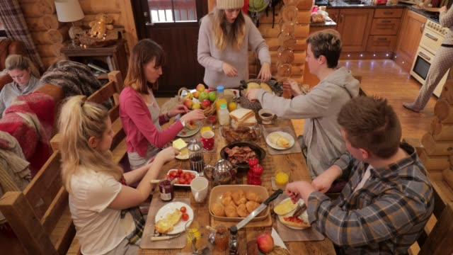 friends enjoying breakfast in a ski lodge - ski holiday stock videos & royalty-free footage