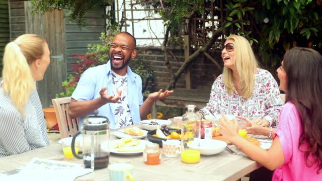 friends enjoying breakfast on patio - fruit bowl stock videos and b-roll footage