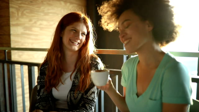 Friends enjoying coffee at the cafe