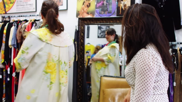 friends enjoying hunt for vintage clothes - second hand stock videos and b-roll footage