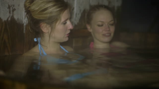 friends enjoying in hot tub - north tirol stock videos & royalty-free footage