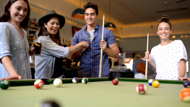 friends enjoying pool game in a bar - bar stock videos & royalty-free footage