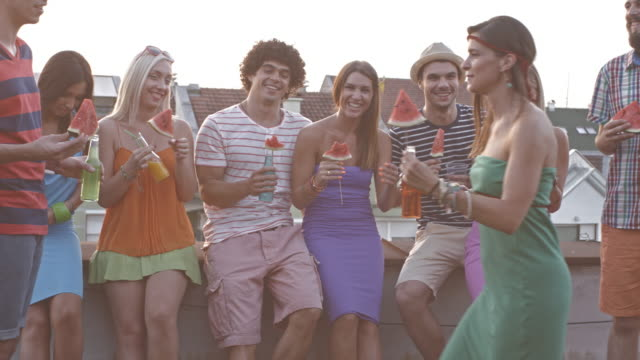 friends enjoying rooftop party - standing stock videos & royalty-free footage