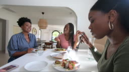 Friends enjoying time together at home preparing food for lunch