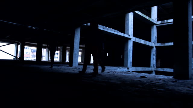 friends exploring abandoned building - abandoned stock videos & royalty-free footage