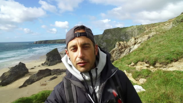 Friends exploring the wild nature in UK and making a social video - Cornwall. 4K Video