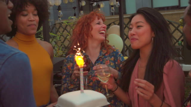 friends gather around a cake - medium group of people stock videos & royalty-free footage