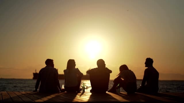 friends gathered by the sea - young men stock videos & royalty-free footage