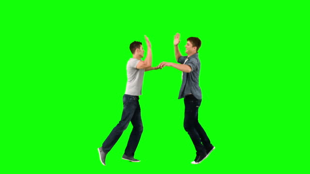 vídeos de stock, filmes e b-roll de friends giving highfive in slow motion - high five