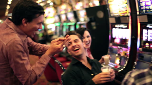 friends goof off at slot machines in las vegas casino - jackpot stock videos and b-roll footage