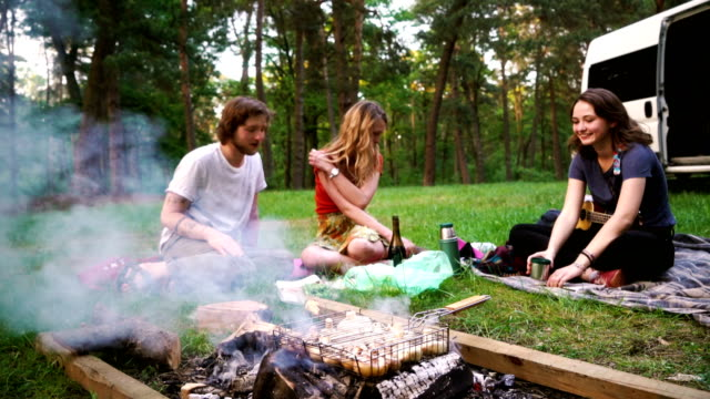 Friends have picnic in the forest