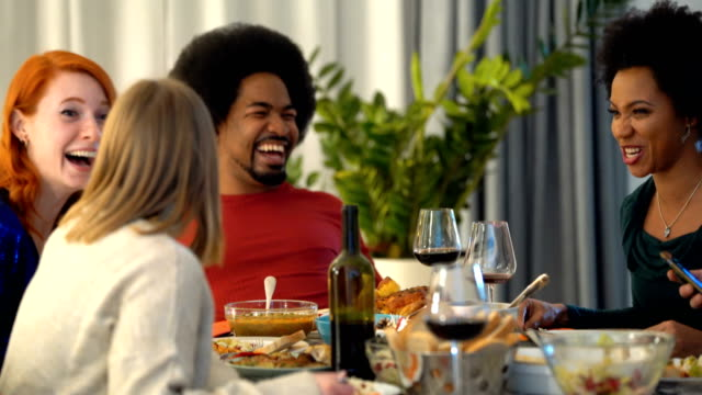 friends having a dinner party. - dinner party stock videos & royalty-free footage