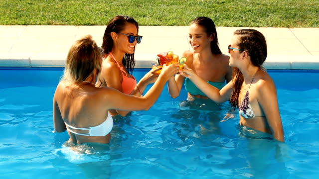 Friends having a pool party.