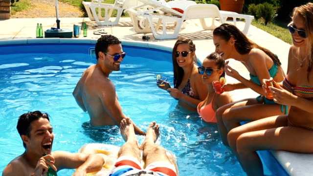 friends having a pool party. - waist deep in water stock videos & royalty-free footage