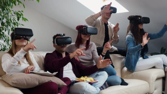friends having a selfie with vr goggles - realtà aumentata video stock e b–roll
