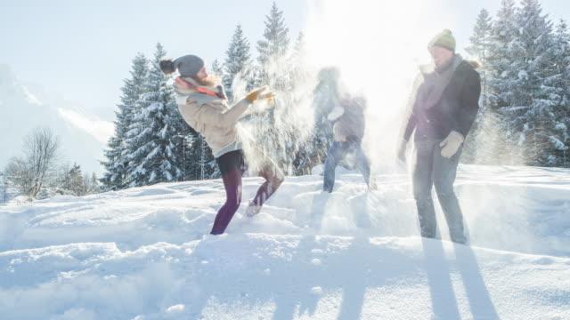 Friends having a snowball fight