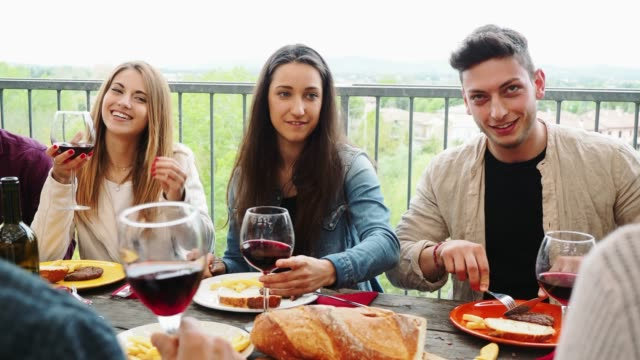 friends having dinner together on the rooftop at home - brunch stock videos & royalty-free footage