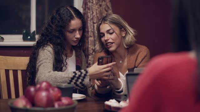 friends having dinner together - teenage girls stock videos & royalty-free footage