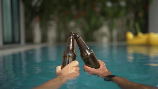 friends having enjoy talking with drinking beer and cocktail at swimming pool outdoors - poolside stock videos & royalty-free footage