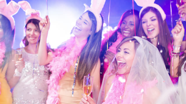 freunde, die spaß an einer bachelorette party - kostümierung stock-videos und b-roll-filmmaterial