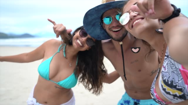 friends having fun at beach - brazilian ethnicity stock videos & royalty-free footage