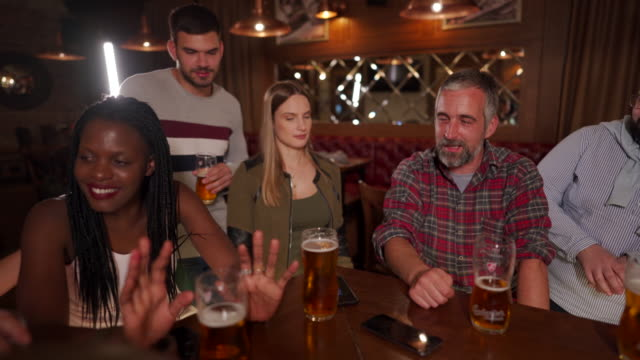 friends having fun at pub - pint glass stock videos & royalty-free footage