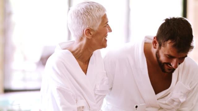 friends having fun at the spa - bathrobe stock videos & royalty-free footage