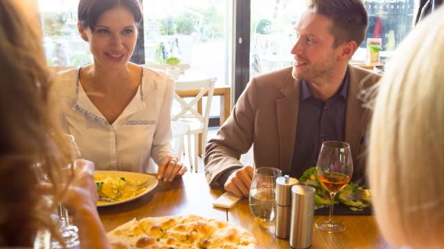 stockvideo's en b-roll-footage met ms friends having fun in restaurant - tafelmanieren