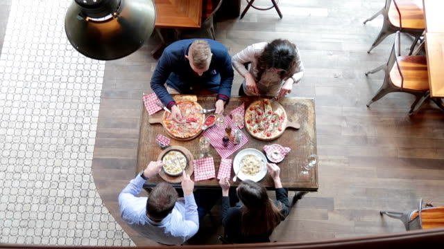 friends having lunch in pizzeria and toasting with wine - lunch stock videos & royalty-free footage
